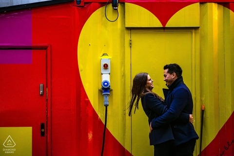 London engagement shoot with street art - Yellow Hearts, with red and purple - Engagement Photographer