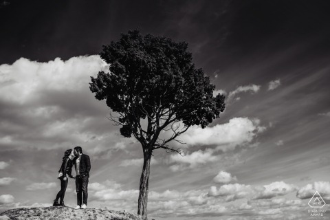 Tuscany Engagament Photo Shoot with Tree and Clouds in Black and White