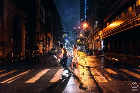 Rain engagement photograph in the streets of Ho Chi Minh city Vietnam