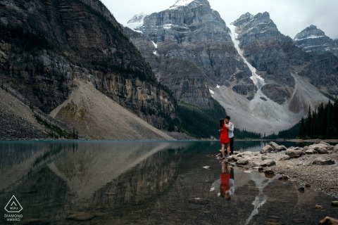 Banff National Park engagement portrait session on the lake with a red dress and reflections