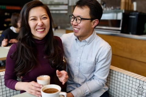 Laughing engaged couple in a coffeeshop - Casual Quebec engagement portrait