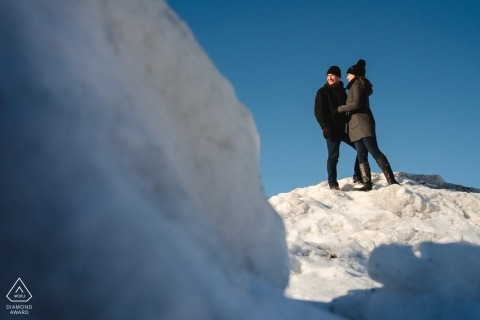Winter engagement portrait with mountain of snow - Winter snow in Old Montreal