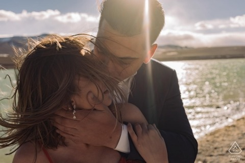 Couple sharing a hug in the wind - São Paulo Engagement Photo