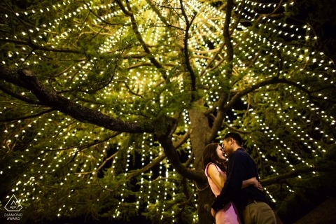 Love beneath the X'mas lightings - California Engagement Photographs