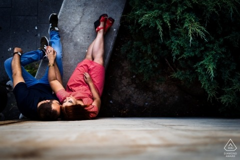 Valladolid pre-wedding session - sitting on concrete holding hands - couple shot from above