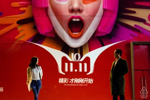 beijing pre-wedding portrait shoot in front of a huge red advertising board