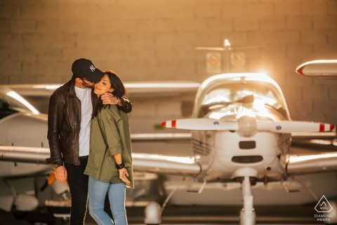 Vicenza Airport Love engagement photos | portrait of a couple with small aircraft