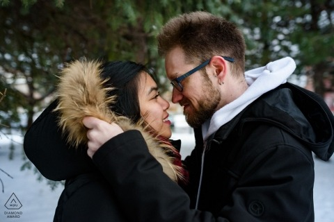 Montreal, Quebec portrait session Among pine trees - Winter engagement photo