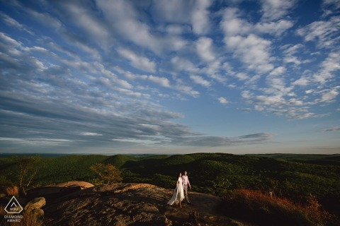 Bear mountain engagement photos - Couple walking on top of the mountain