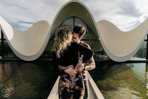 Franschhoek engagement portraits - The organic forms of the small chapel take the eyes of the couple in an endless looping