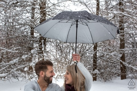 Milton, Ontario engagement photos - The umbrella, the snow, the couple and their love