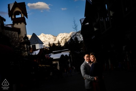 Downtown Vail Colorado engagement portrait shoot with the Gore Range lit by the last bits of light for this couple's session.