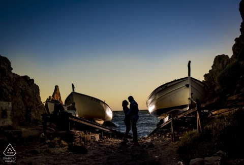 Cabo de Gata Sunset pre-wedding portrait at the beach between two boats