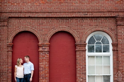 Boston, MA engagement portraits - Couple in blanked out red window frame