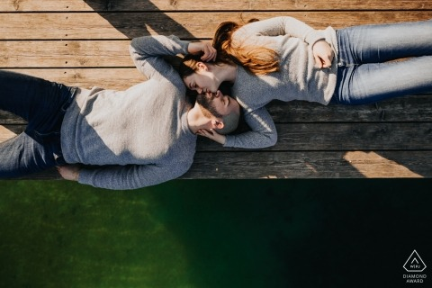 Höfnerhäuser, Austria pre-wedding Photos | a couple Kissing on the pier as seen from above