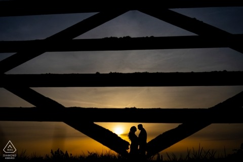 Rockbeare Manor Sunset engagement shoot - portrait with A gate and a couple
