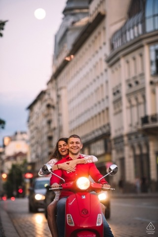 Sofia, Bulgaria engagement portraits - red Vespa lovers in the city