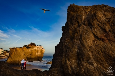 Malibu, California Beach Engagement Session near the edge of the water and cliffs