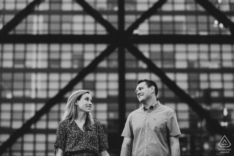 Washington DC couple Pose for engagement portraits - black-and-white In to triangles