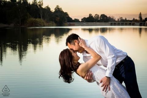 Vasona Lake, Los Gatos Engagement Portrait session | he dips his fiancée near the lake at Sunset