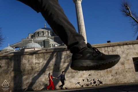 Istanbul pre-wedding shooting at a mosque | couple running in the street