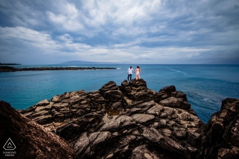 Kapalua, Hawaii Engagement Portrait Session - Couple on the rocks over at Cliffhouse in Maui, Hawaii