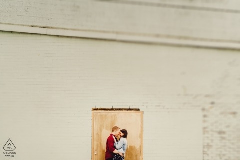 London Pre-Wedding Engagement Photography - Couple standing in door frame with tilt shift