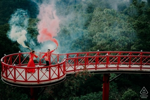 Vietnam Da Lat Engagement Photoshoot with Smoke Grenades on a Red Bridge