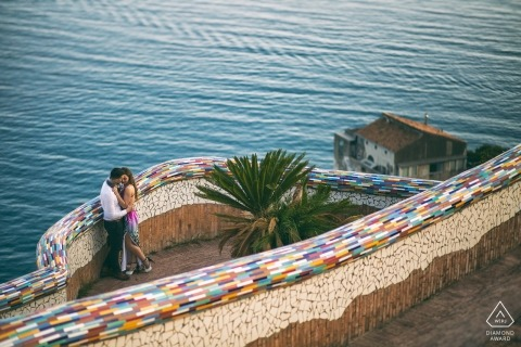 Couple kisses on a rainbow tiled walkway in this Vietri Sul Mare - Salerno engagement photo session