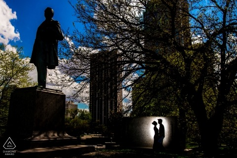 In Lincoln Park, Chicago, a couples silhouette is captured against a monument in this engagement photo shoot