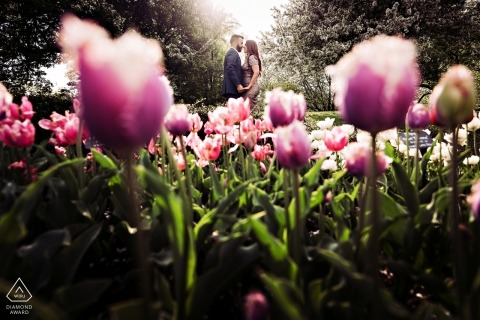 Engagement Photo Session at the Brooklyn Botanic Garden, NY - Flowers blooming with the couple.
