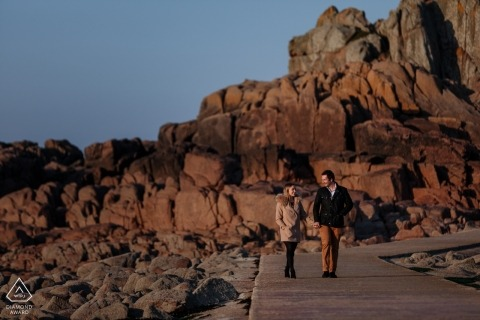 Engagement Portrait Session at Corbiere Lighthouse, St Brelades, Jersey, CI - Coastal engagement shoot of a couple walking together