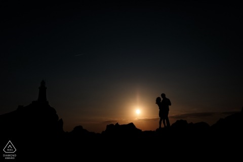 Corbiere Lighthouse, St Brelades, Jersey, CI Engagement Portrait - A silhoutte of a engaged couple