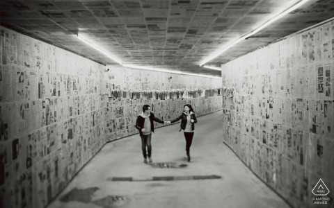 Guangdong- couple runs hand in hand down a tunnel in this black and white pre-wedding portrait