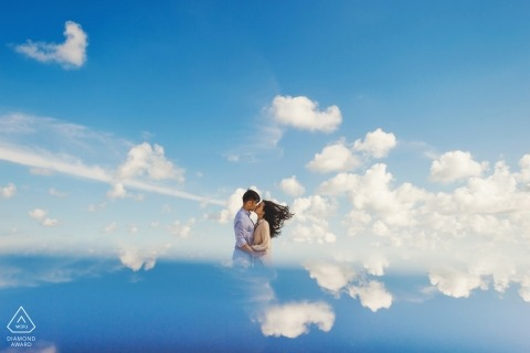 Fuijan- the couple appear to be kissing in the clouds in this pre-wedding portrait session