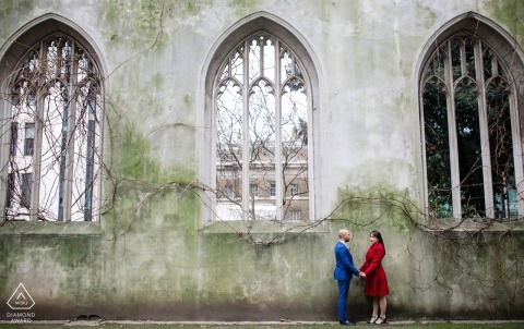 St Dunstan Engagement Portrait in the East church garden - Couple posing by the wall