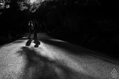 Cercedilla, Madrid (Spain) engagement session with backlighting couple in a road