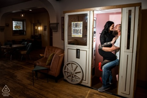 Minneapolis Glam Doll engagement photo session in a booth