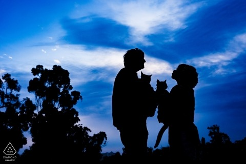 Balboa Park, San Diego Engagement Portraits - Couple and their cats silhouetted