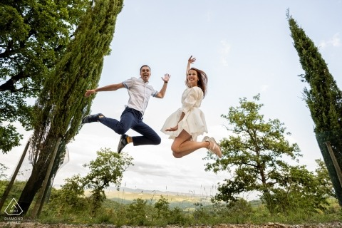 Castellina in Chianti, Siena - Jumping engagement portrait in the trees!