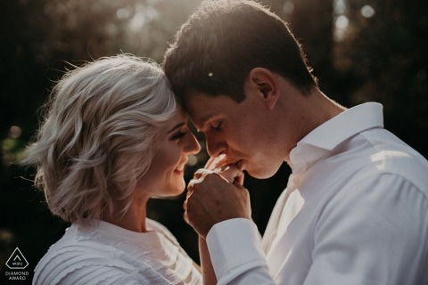 In San Francisco, a man kisses his fiance's hand during their engagement session by a Sacramento, CA photographer.