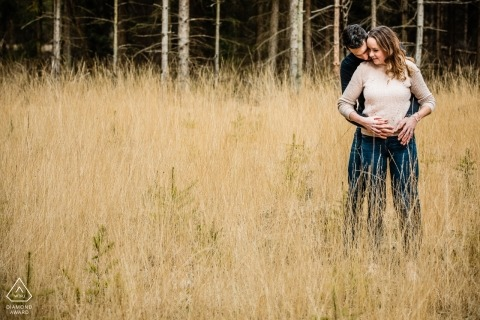 Outdoor photo of engaged couple hugging in a field during their Engagement shoot in Landgoed den Treek