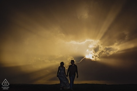 Arabia Mountain, Georgia | Sun rays break through the clouds for this creative engagement portrait