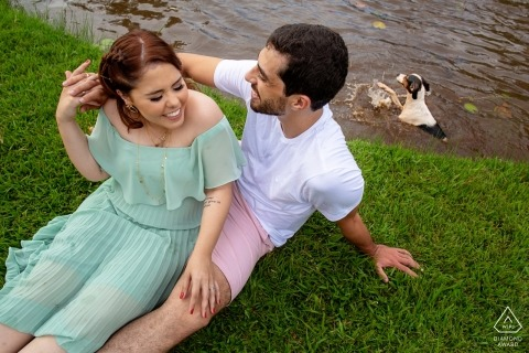 The Engaged couple sit and smile during their Pre-wedding session