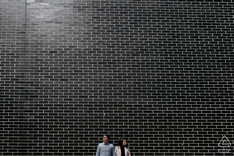 portrait of the engaged couple with a huge wall for their Chicago engagement shoot