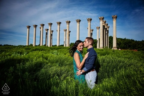 Engaged couple in a field for their DC engagement session
