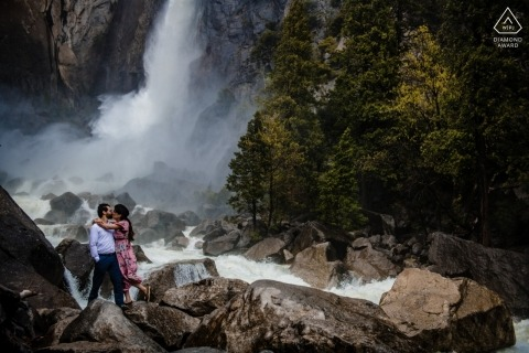 Engaged couple kiss during their engagement shoot in Yosemite National Park