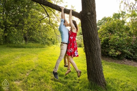 Arnold Arboretum, Jamiaca Plain, Massachusetts - Couple hanging from tree kissing