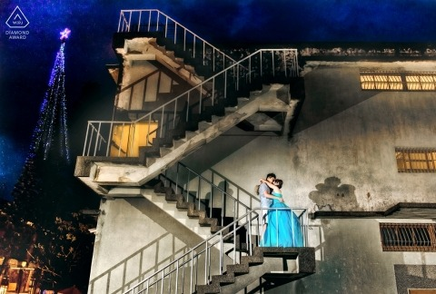 A couple kissing on a stairwell in Hualien was captured by a Taiwan engagement photographer
