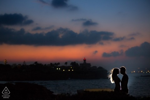 The sun has set but the couple is illuminated by a light on the dock in this prewedding photoshoot in Siracusa